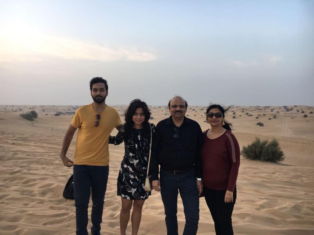 Family in Dubai sand dunes
