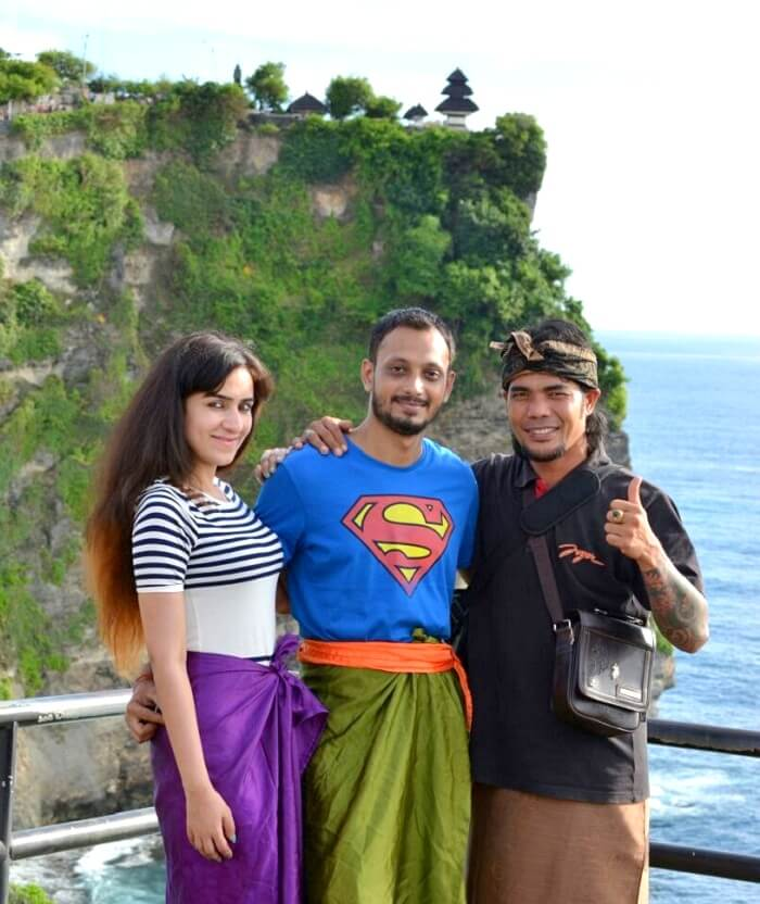 Sanchit and his wife click a picture with the local of Bali