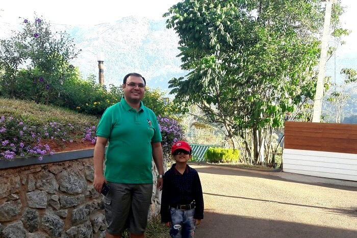 father and son sharing a moment in Munnar