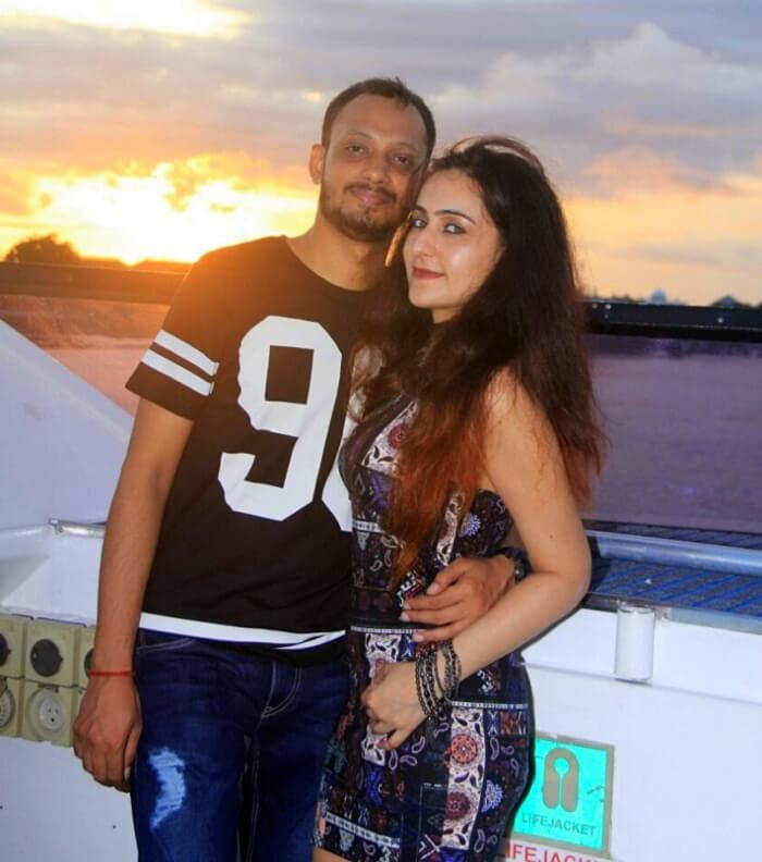 Sanchit and his wife in the background of sunset on the bali high sunset cruise