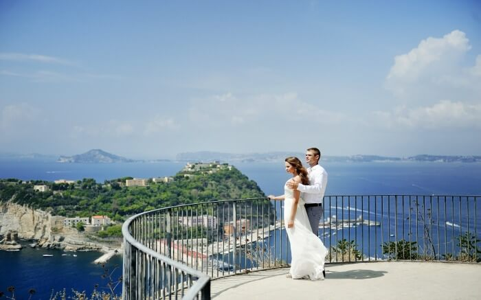 A couple enjoying the views of Naples - one of the best honeymoon destinations in Italy