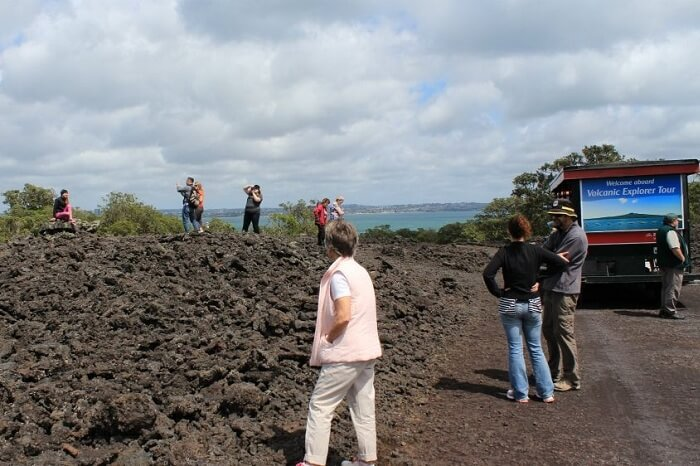 A group taking the famous Rangitoto Island Volcanic Explorer Tour in Auckland
