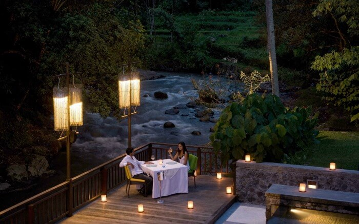 A couple enjoying hundred candles dinner in Bali