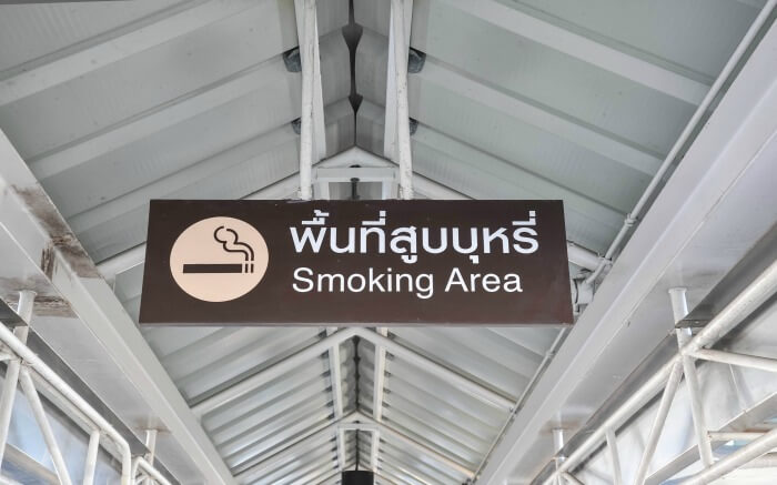 Board with no smoking sign in Thailand