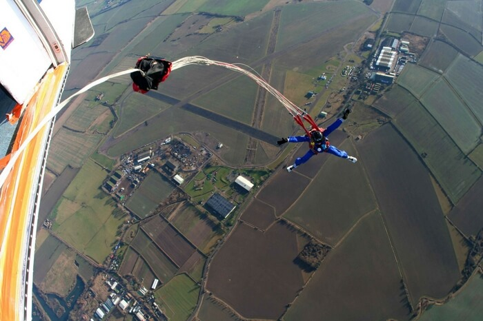 An adventurer going for static line skydiving in New Zealand