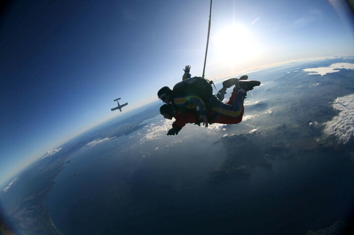 Beautiful view of skydivers in Rotorua in New Zealand