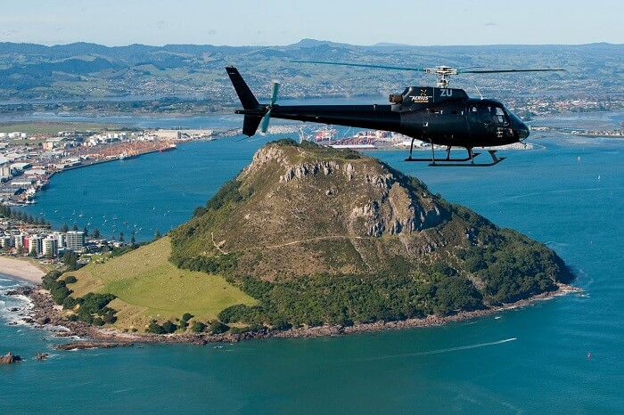 A helicopter flying over the lands of Auckland