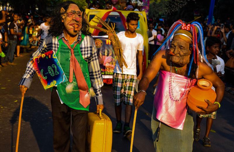 two men wearing shaggy skin mask in Goa carnival