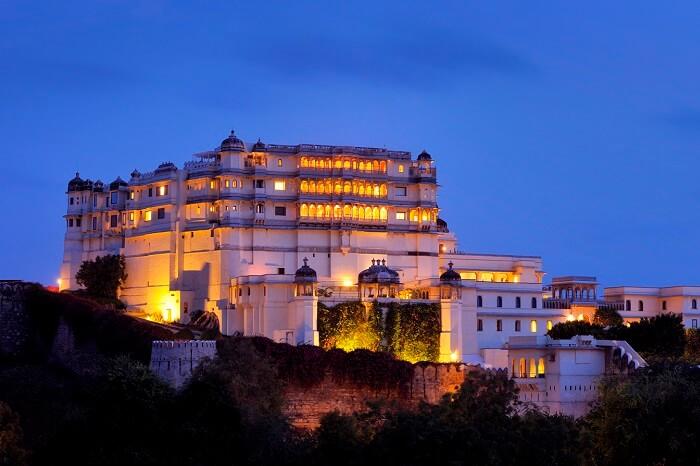 A night shot of the Devi Garh Fort in Delwara
