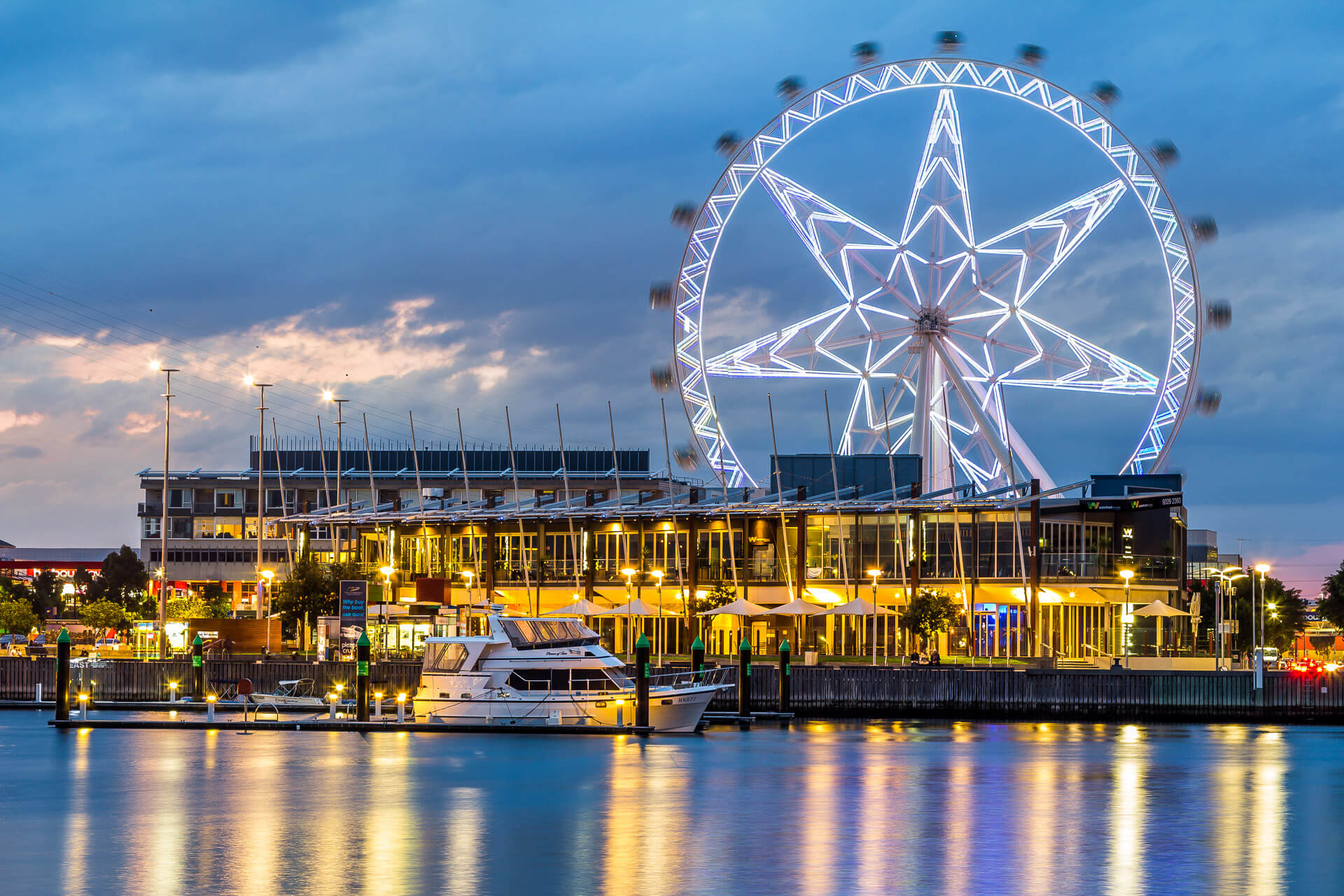 docklands and observation wheel decorated with lights