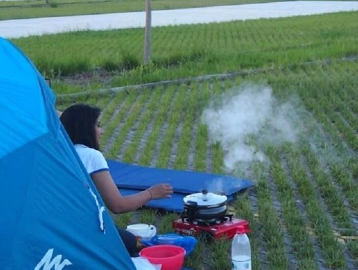 Punita cooking food on the go during their road trip to Paris