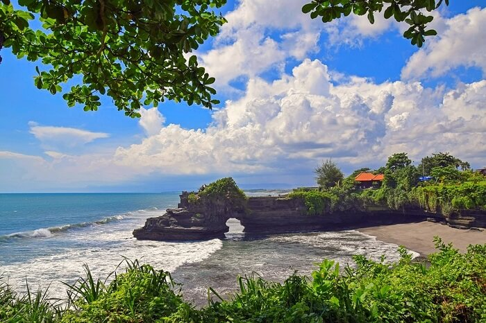 Bow down at Tanah Lot temple in Bali, Indonesia