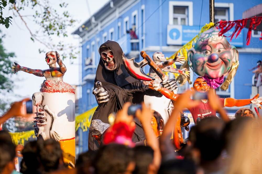 people wearing scary masks in Goa carnival