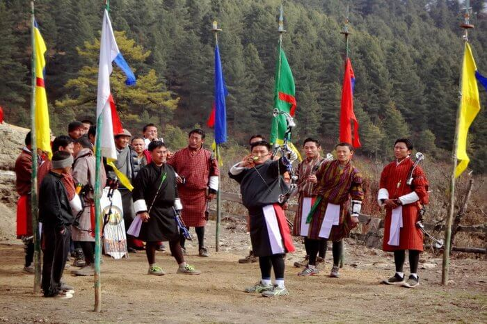 Bhutanese men participating in an archery competition