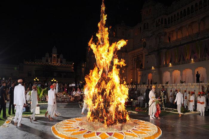 people celebrating holika dahan at City Palace