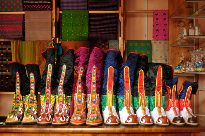 Colourful boots in a shop in Norzin Lam
