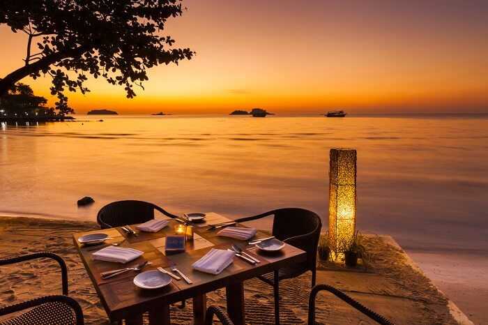 Romantic sunset on the beachfront cafe of a Koh Chang in Thailand