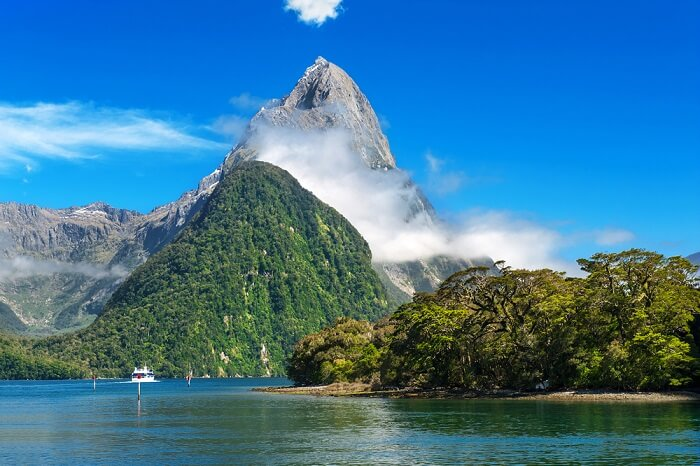 Mitre Peak rising by Milford Sound Fiord