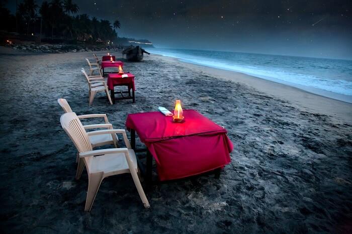 Romantic tropical cafe on the beach near the ocean in Varkala