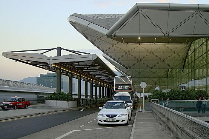 a white taxi at Hong Kong airport