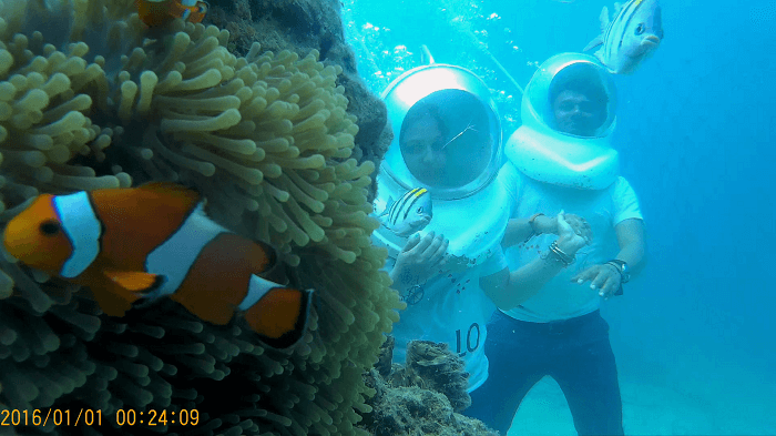 Couple enjoying Underwater seawalking in Andaman