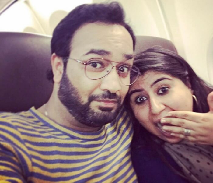 Neha and her husband on their flight to Vietnam