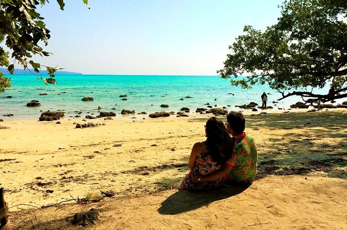 Couple sitting on the beach in Andaman