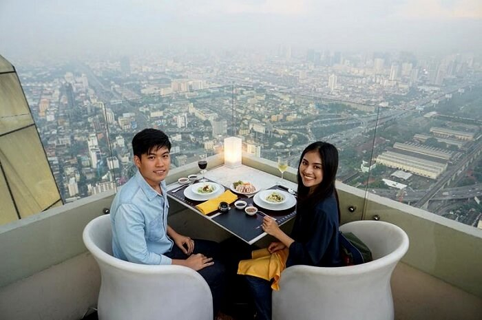 couple dining at a rooftop restaurant Bangkok