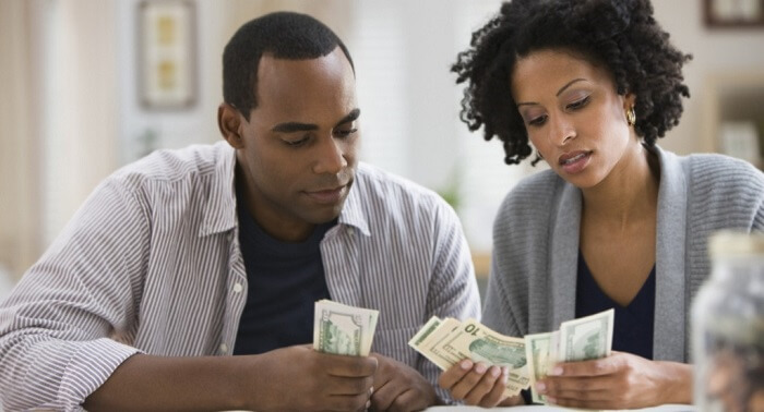 Couple fixing a budget for honeymoon