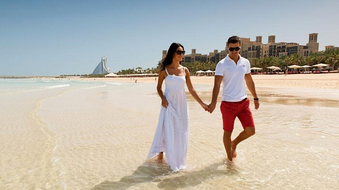 Romantic couple walking at Jumeirah Beach, Dubai