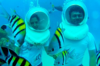 Underwater seawalking couple in Andaman