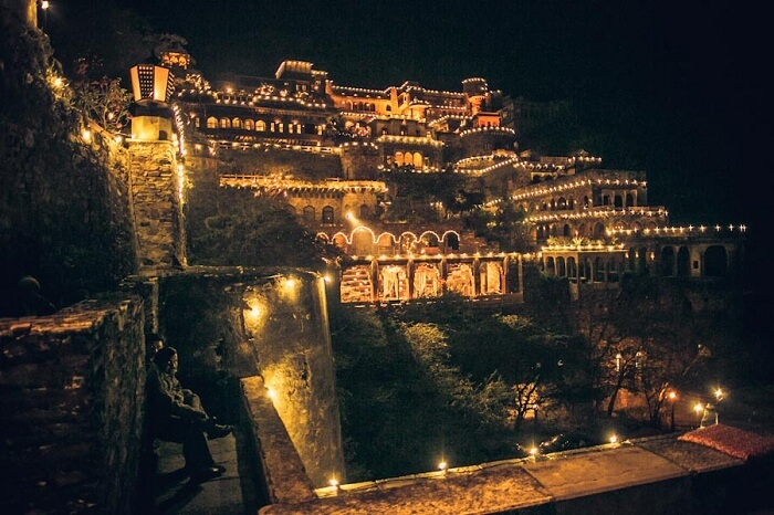 A distant shot of Neemrana Fort lit up for a wedding