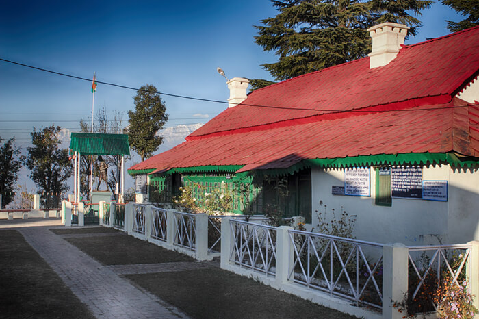 Backside of Anashakti Ashram with red tin roof