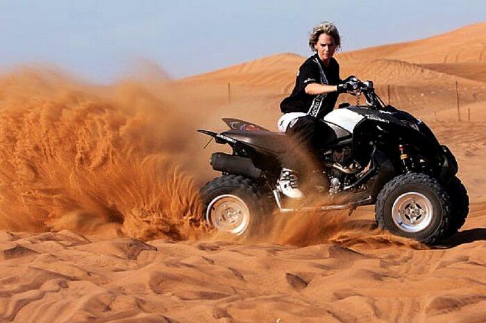 Traveler taking up dune bashing during desert safari in Dubai
