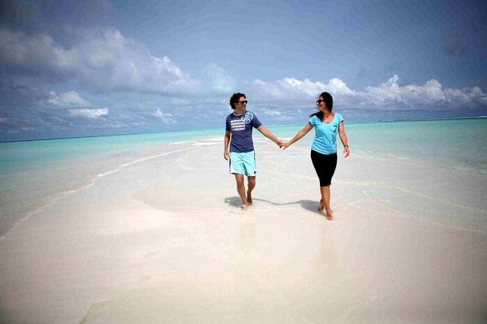Couple at fulhadhoo beach maldives