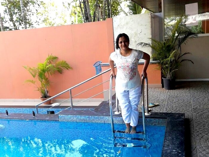 Swimming in resort in Kerala