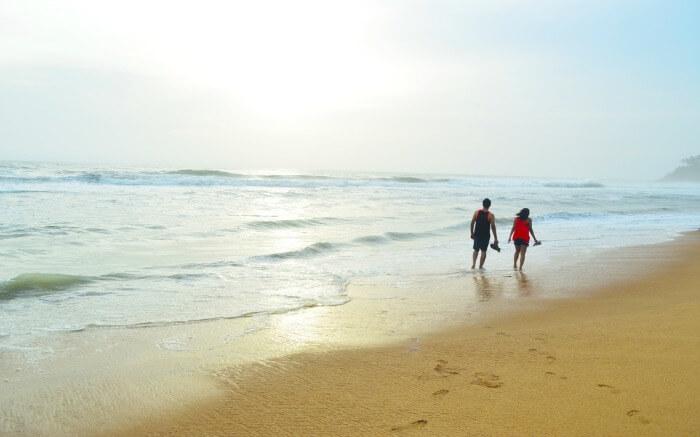 A couple on a beach in Kerala