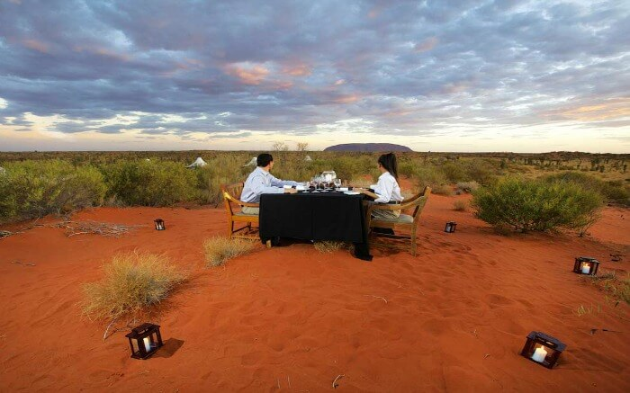 A couple dining in Longitude 131°