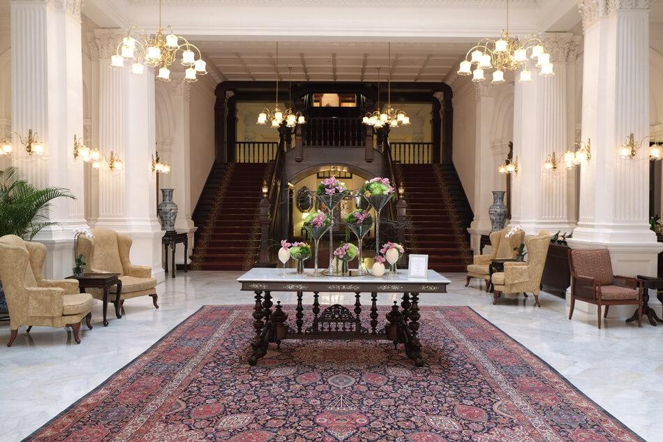 the lobby area of Raffles Hotel Singapore