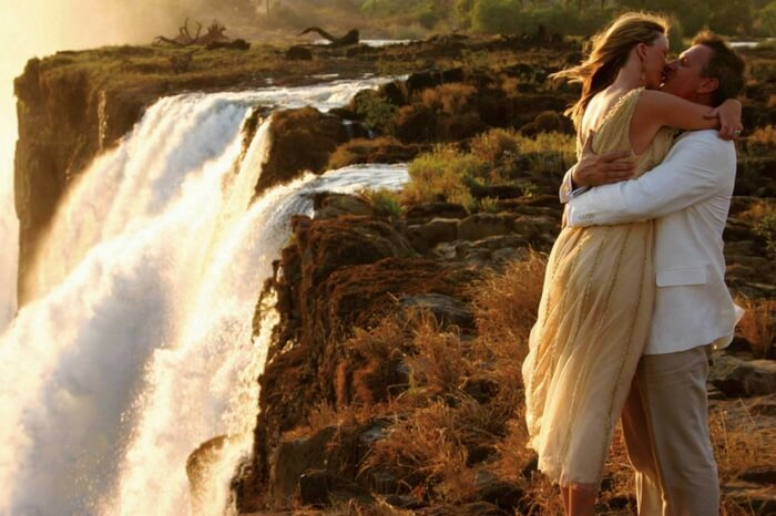 Couple kissing each other by a waterfall near Kruger National Park