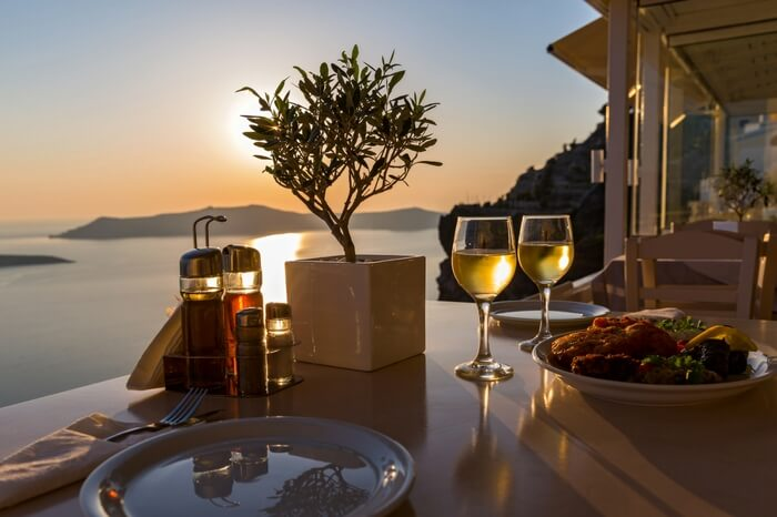Romantic dining setup by the sea in Santorini in Greece
