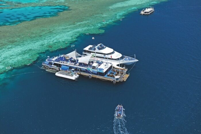 Aerial view of cruise standing by the shore of Hamilton island in Australia