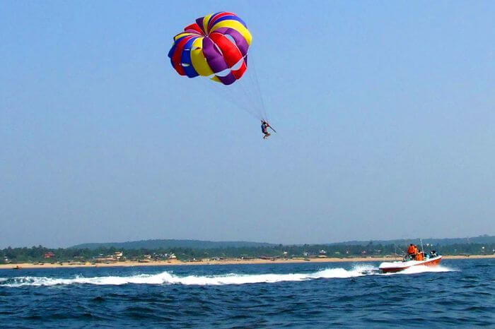 a guy parasailing over Arabian sea