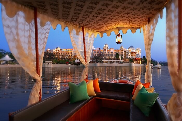decorated luxury boat in Lake Pichola near Leela Palace in Udaipur