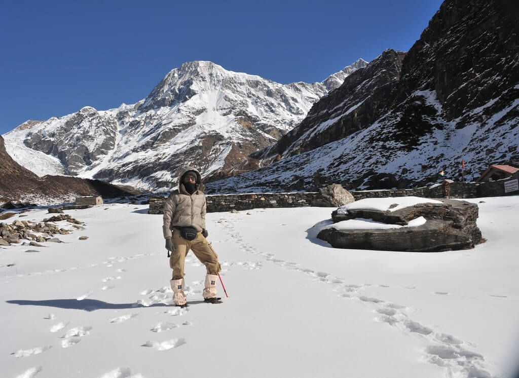 a man trekking Pindari Glacier in heavy snow