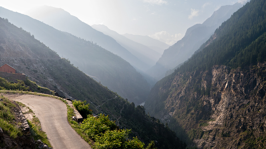 a road with a beautiful view of mountains