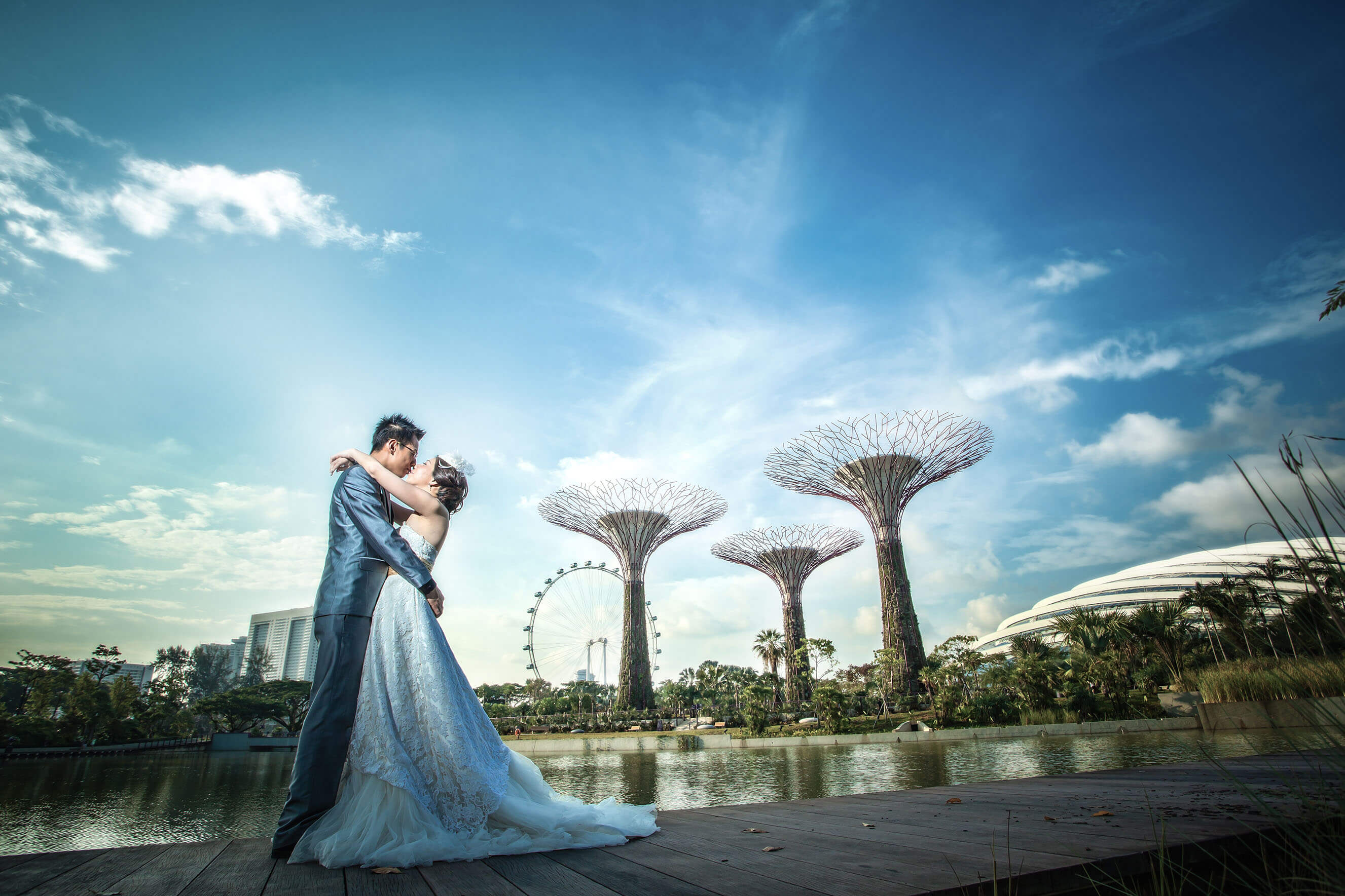 romantic couple holding each other in Gardens By The Bay