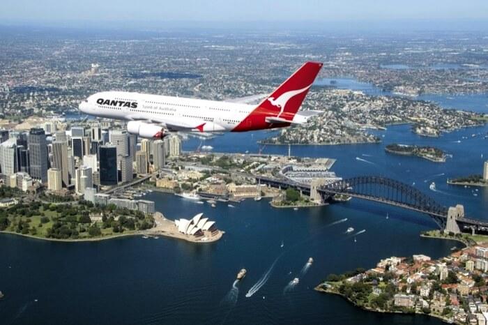 Plane flying over Sydney Bridge in Australia