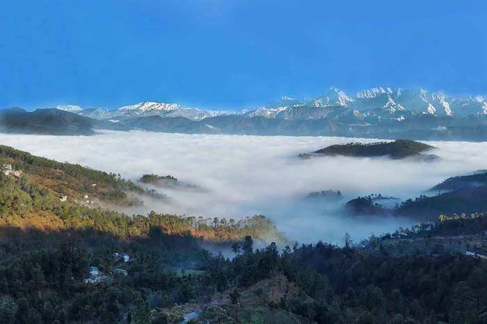 mountains covered under fog