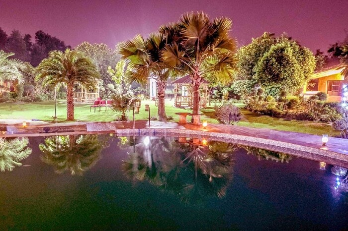 An evening shot of the pool at the Botanix Resort near Gurgaon